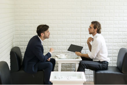 Two men in a meeting