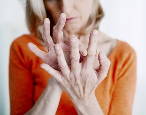 Woman with joint pain in her fingers